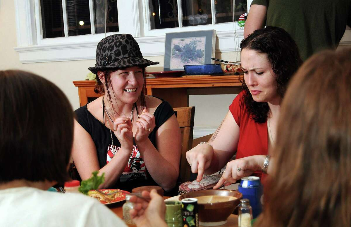 Amanda Furlow and Angie Hayes chat during a weekly dinner held for Ruth Haus and Rosalie Haus residents SundayJan. 20, 2013.(Dave Rossman/For the Chronicle)