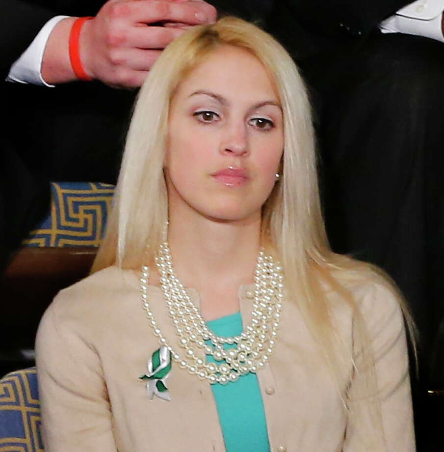 Sandy Hook Elementary School teacher  Kaitlin Roig listens as President Barack Obama gives his State of the Union address during a joint session of Congress on Capitol Hill in Washington, Tuesday Feb. 12, 2013. Photo: J. Scott Applewhite, AP Photo/J. Scott Applewhite / AP2013 associated press