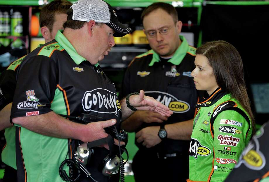 Daytona 500 pole sitter Danica Patrick, right, talks to crew chief Tony Gibson during a practice for the Daytona 500 NASCAR Sprint Cup Series auto race Friday, Feb. 22, 2013, at the Daytona International Speedway in Daytona Beach, Fla. (AP Photo/Chris O'Meara) Photo: Chris O'Meara