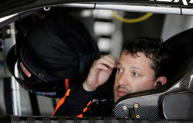 Tony Stewart waits in his car in his garage before going out on the track during a practice session for the NASCAR Daytona 500 Sprint Cup Series auto race at Daytona International Speedway, Friday, Feb. 22, 2013, in Daytona Beach, Fla. (AP Photo/John Raoux) Photo: John Raoux