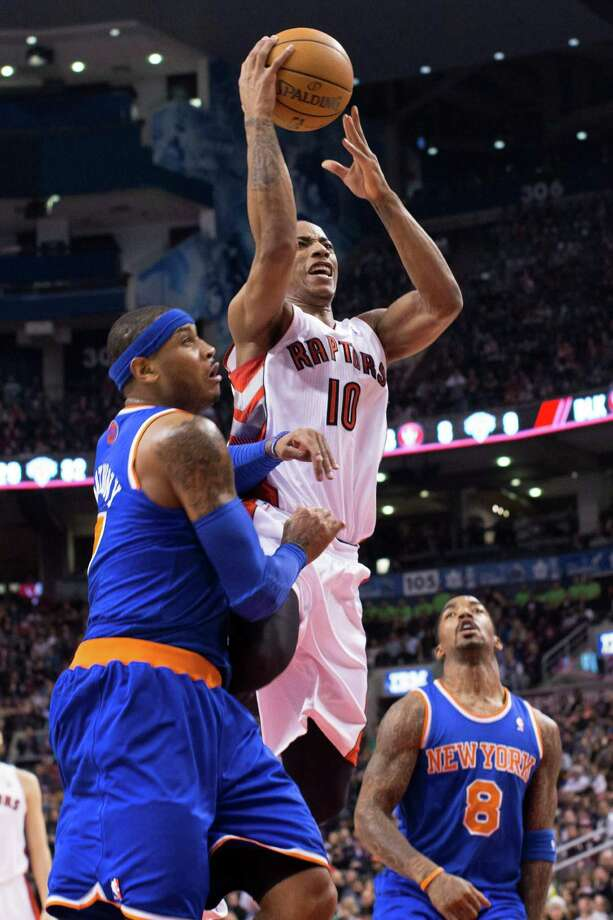 Toronto Raptors' DeMar DeRozan shoots above New York Knicks' Carmelo Anthony, left, and J.R. Smith during the first half of an NBA basketball game in Toronto on Friday, Feb. 22, 2013. (AP Photo/The Canadian Press, Chris Young) Photo: Chris Young