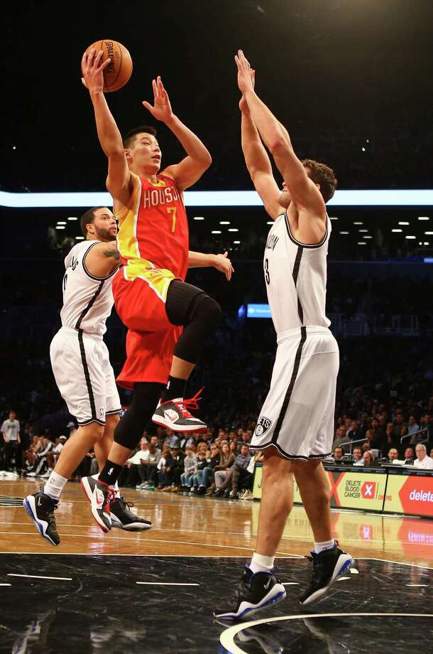 NEW YORK, NY - FEBRUARY 22:  Jeremy Lin #7 of the Houston Rockets shoots against Kris Humphries #43 of the Brooklyn Nets  during their game at the Barclays Center on February 22, 2013 in the Brooklyn borough of New York City. NOTE TO USER: User expressly acknowledges and agrees that, by downloading and/or using this photograph, user is consenting to the terms and conditions of the Getty Images License Agreement.  (Photo by Al Bello/Getty Images) Photo: Al Bello