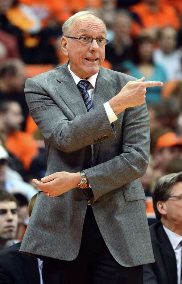 Syracuse head coach Jim Boeheim gestures to his players during the second half against Providence in an NCAA college basketball game in Syracuse, N.Y., Wednesday, Feb. 20, 2013. Syracuse won 84-59. (AP Photo/Kevin Rivoli) Photo: KEVIN RIVOLI