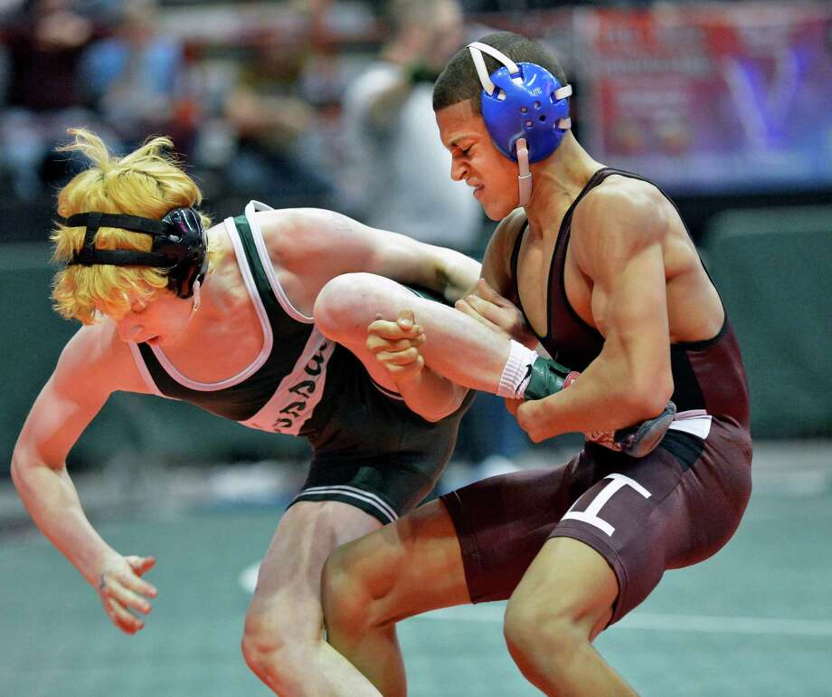 Luis Weierbach of Hoosick Falls, at right, on his way to defeating Hunter Dusold of Locust Valley in a 113lb. quarterfinal match at the state wrestling tournament at the Times Union Center in Albany Friday Feb. 22, 2013.  (John Carl D'Annibale / Times Union) Photo: John Carl D'Annibale / 00021228A