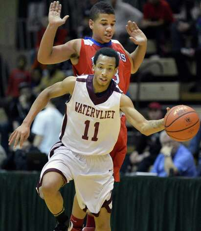 Watervliet's  #11 Shane Ray, drives past Broadalbin-Perth's  #3 Andre Taylor during Friday's game at HVCC in Troy Feb. 22, 2013.   (John Carl D'Annibale / Times Union) Photo: John Carl D'Annibale / 00021258A