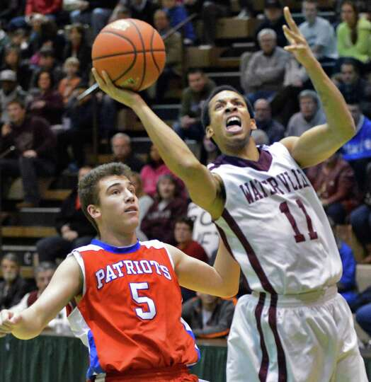 Watervliet's  #11 Shane Ray, at right, goes to the basket against Broadalbin-Perth's  #5 Mark Sylvia
