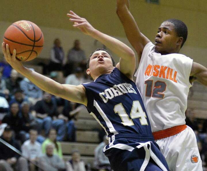 Cohoes' #14 Elijah Newsome, left, is fouled by Catskill's #12 Nigel Gray during Friday's game at HVC