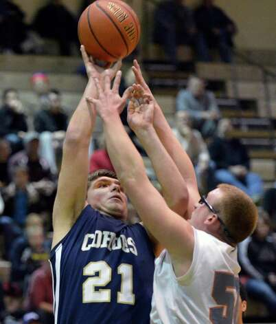 Cohoes' #21 AJ Cioffi, left, and Catskill's #50 Hans Schmidt vie for  rebound during Friday's game at HVCC in Troy Feb. 22, 2013.   (John Carl D'Annibale / Times Union) Photo: John Carl D'Annibale / 00021258A