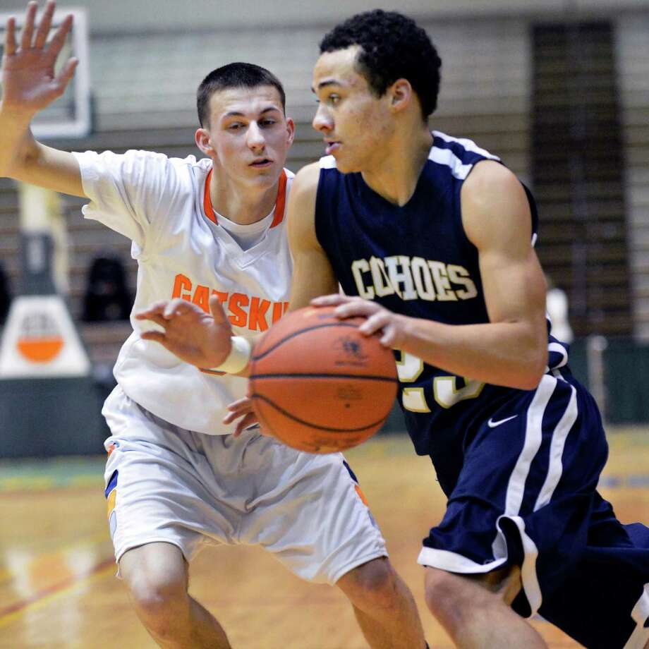 Cohoes' #23 Shelton Alston, at right drives past Catskill's #34 Christian Coutu during Friday's game at HVCC in Troy Feb. 22, 2013.   (John Carl D'Annibale / Times Union) Photo: John Carl D'Annibale / 00021258A