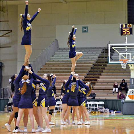 Cohoes cheerleaders perform during Friday's game against Catskill at HVCC in Troy Feb. 22, 2013.   (John Carl D'Annibale / Times Union) Photo: John Carl D'Annibale / 00021258A