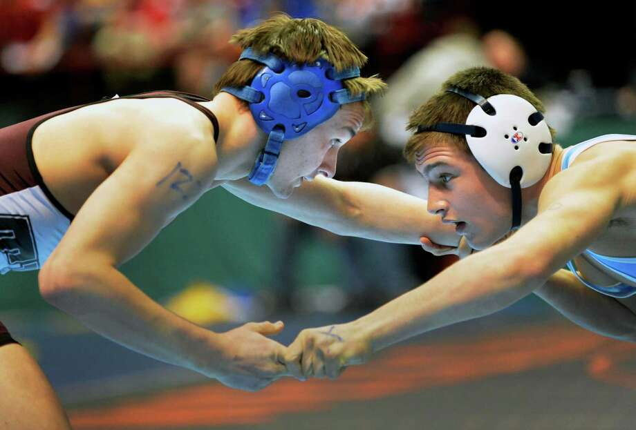 Shaker's Blake Retell, left, and John Muldoon of Pearl River during a 120lb. quarterfinal match at the state wrestling tournament at the Times Union Center in Albany Friday Feb. 22, 2013.  (John Carl D'Annibale / Times Union) Photo: John Carl D'Annibale / 00021228A