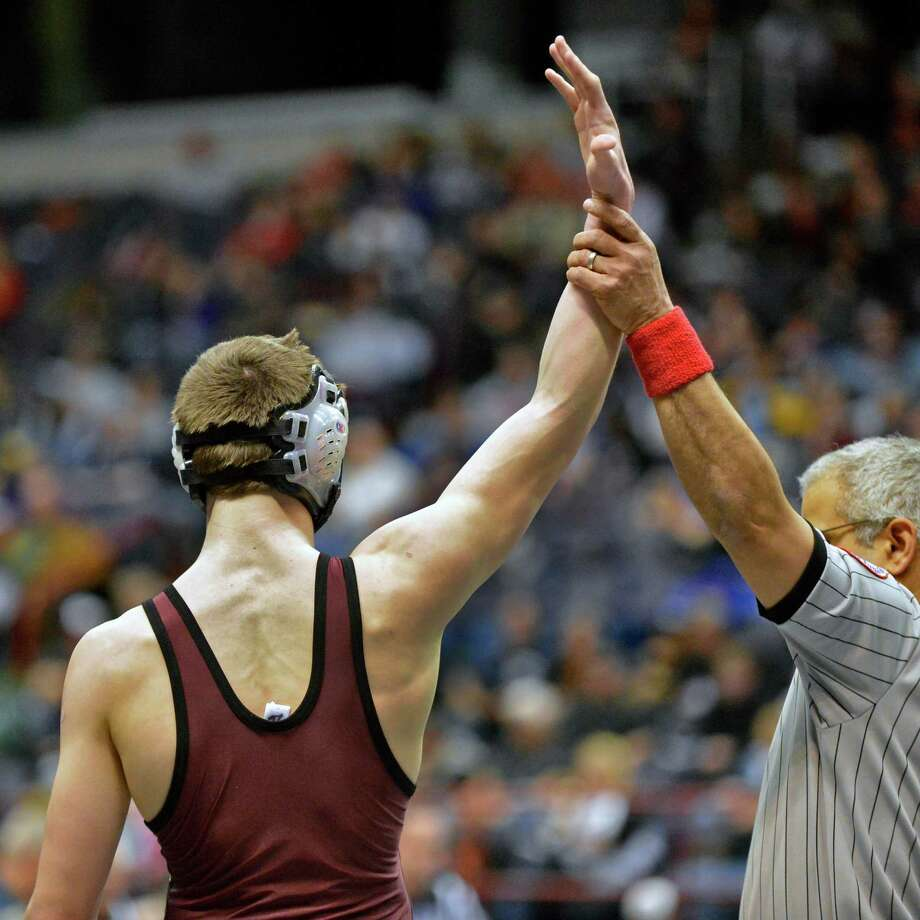 Joey Butler of Burnt Hills has his hand raised after beating Tommy Dutton of Rocky Point in a 138 lb. quarterfinal match at the state wrestling tournament at the Times Union Center in Albany Friday Feb. 22, 2013.  (John Carl D'Annibale / Times Union) Photo: John Carl D'Annibale / 00021228A