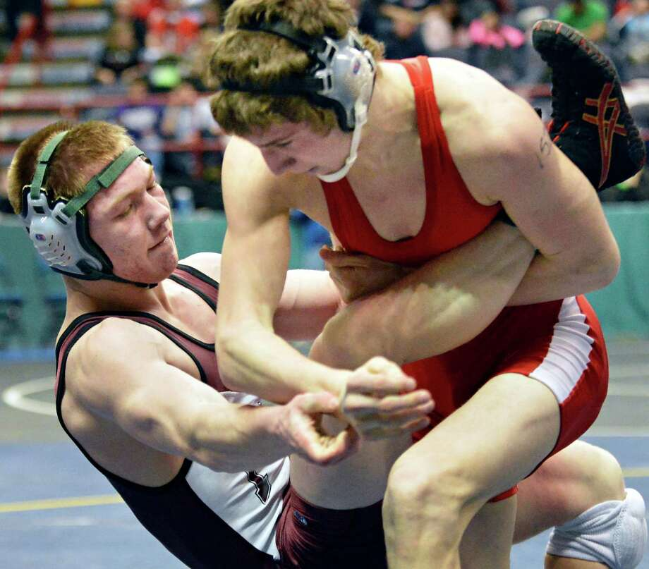 Shen's Zach Joseph, left, and Johnson City's Zach Colgan wrestle during a 152 lb. quarterfinal match at the state wrestling tournament at the Times Union Center in Albany Friday Feb. 22, 2013.  (John Carl D'Annibale / Times Union) Photo: John Carl D'Annibale / 00021228A