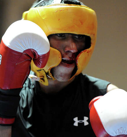 Marc Salas face bleeds during the Novice Flyweight Championship during the San Antonio Golden Gloves tournament at Woodlawn Gym, Friday, Feb. 22, 2013. Photo: JOHN ALBRIGHT, For The Express-News / San Antonio Express-News