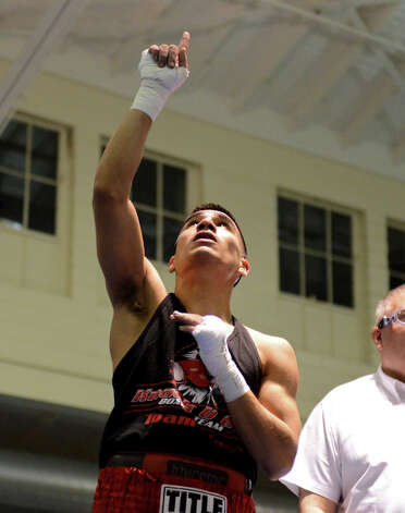 Michael Mendez celebrates after defeating Daniel Reed during the Sub Novice Flyweight Championship of the San Antonio Golden Gloves tournament at Woodlawn Gym, Friday, Feb. 22, 2013. Photo: JOHN ALBRIGHT, For The Express-News / San Antonio Express-News