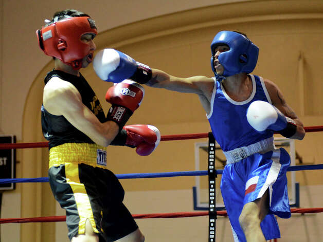 Nicholas Garcia (right) throws a punch as he fights Edson Lozano (left) during the Sub-Novice Light Flyweight Championship of the San Antonio Golden Gloves tournament at Woodlawn Gym, Friday, Feb. 22, 2013. Photo: JOHN ALBRIGHT, For The Express-News / San Antonio Express-News
