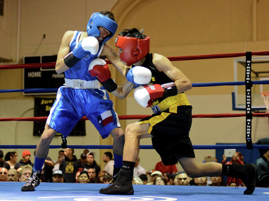 Nicholas Garcia (left) fights Edson Lozano (right) during the Sub-Novice Light Flyweight Championship  during the San Antonio Golden Gloves tournament at Woodlawn Gym, Friday, Feb. 22, 2013. Photo: JOHN ALBRIGHT, For The Express-News / San Antonio Express-News