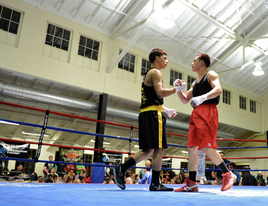 Jose Olivarez (right) shakes hands with Raul Cervantes (left) after the Sub Novice Lightweight Championship of the San Antonio Golden Gloves tournament at Woodlawn Gym, Friday, Feb. 22, 2013. Photo: JOHN ALBRIGHT, For The Express-News / San Antonio Express-News
