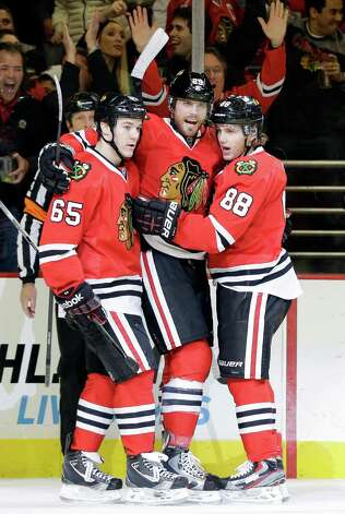 Chicago Blackhawks' Viktor Stalberg, center, celebrates with Andrew Shaw, left, and Patrick Kane after scoring a goal during the second period of an NHL hockey game against the San Jose Sharks in Chicago, Friday, Feb. 22, 2013. (AP Photo/Nam Y. Huh) Photo: Nam Y. Huh