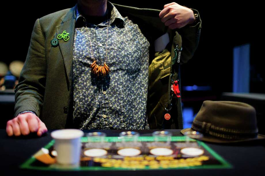 Dave McAdams shows off his drinking jacket - laden with bottle openers and caps. Photo: JORDAN STEAD / SEATTLEPI.COM / SEATTLEPI.COM