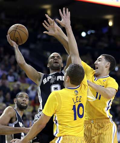 San Antonio Spur's Tony Parker, left, shoots between Golden State Warriors' David Lee (10) and Klay Thompson, right, during the first half of an NBA basketball game Friday, Feb. 22, 2013, in Oakland, Calif. (AP Photo/Ben Margot) Photo: Ben Margot, Associated Press