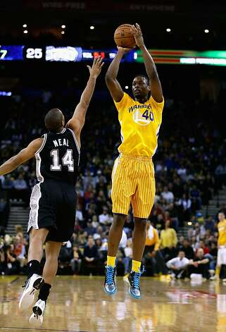 OAKLAND, CA - FEBRUARY 22:  Harrison Barnes #40 of the Golden State Warriors shoots over Gary Neal #14 of the San Antonio Spurs at Oracle Arena on February 22, 2013 in Oakland, California. The Warriors are wearing new short-sleeved uniforms for the first time.   NOTE TO USER: User expressly acknowledges and agrees that, by downloading and or using this photograph, User is consenting to the terms and conditions of the Getty Images License Agreement.  (Photo by Ezra Shaw/Getty Images) Photo: Ezra Shaw, Getty Images