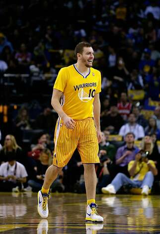 OAKLAND, CA - FEBRUARY 22:  David Lee #10 of the Golden State Warriors smiles as he walks on to the court wearing a new short-sleeved uniform before their game against the San Antonio Spurs at Oracle Arena on February 22, 2013 in Oakland, California. NOTE TO USER: User expressly acknowledges and agrees that, by downloading and or using this photograph, User is consenting to the terms and conditions of the Getty Images License Agreement.  (Photo by Ezra Shaw/Getty Images) Photo: Ezra Shaw, Getty Images