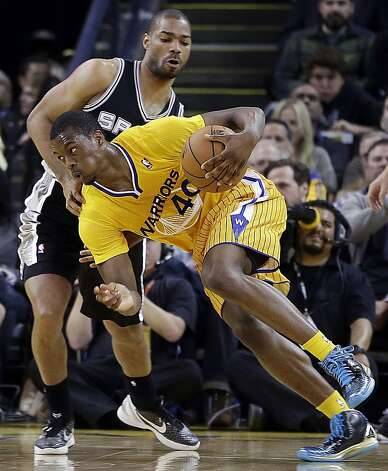 Golden State Warriors' Harrison Barnes (40) drives the ball past San Antonio Spurs' Gary Neal during the first half of an NBA basketball game Friday, Feb. 22, 2013, in Oakland, Calif. (AP Photo/Ben Margot) Photo: Ben Margot, Associated Press