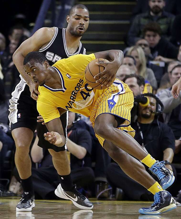 Harrison Barnes, driving against San Antonio's Gary Neal, struggled with his shot on the road but has heated up at home. Photo: Ben Margot, Associated Press
