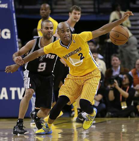 San Antonio Spurs' Tony Parker (9) and Golden State Warriors' Jarrett Jack, right, eye a loose ball during the second half of an NBA basketball game Friday, Feb. 22, 2013, in Oakland, Calif. (AP Photo/Ben Margot) Photo: Ben Margot, Associated Press