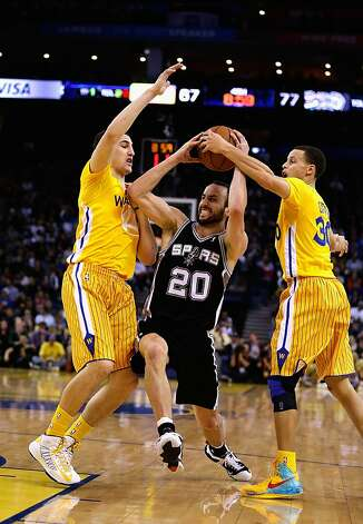 OAKLAND, CA - FEBRUARY 22: Manu Ginobili #20 of the San Antonio Spurs drives between Klay Thompson #11 and Stephen Curry #30 of the Golden State Warriors at Oracle Arena on February 22, 2013 in Oakland, California. The Warriors are wearing new short-sleeved uniforms for the first time. The Warriors won the game in overtime.  NOTE TO USER: User expressly acknowledges and agrees that, by downloading and or using this photograph, User is consenting to the terms and conditions of the Getty Images License Agreement.  (Photo by Ezra Shaw/Getty Images) Photo: Ezra Shaw, Getty Images