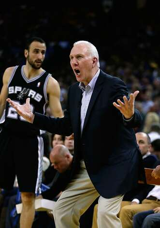 OAKLAND, CA - FEBRUARY 22: Head coach Gregg Popovich of the San Antonio Spurs shouts to his team during their loss to the Golden State Warriors at Oracle Arena on February 22, 2013 in Oakland, California. NOTE TO USER: User expressly acknowledges and agrees that, by downloading and or using this photograph, User is consenting to the terms and conditions of the Getty Images License Agreement.  (Photo by Ezra Shaw/Getty Images) Photo: Ezra Shaw, Getty Images