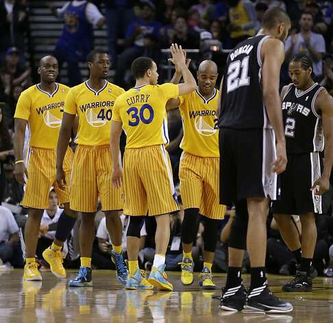 Golden State Warriors' Jarrett Jack (2) is congratulated by teammates including Stephen Curry (30) during the second half of an NBA basketball game against the San Antonio Spurs Friday, Feb. 22, 2013, in Oakland, Calif. (AP Photo/Ben Margot) Photo: Ben Margot, Associated Press