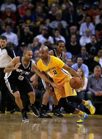 OAKLAND, CA - FEBRUARY 22: Jarrett Jack #2 of the Golden State Warriors drives on Tony Parker #9 of the San Antonio Spurs at Oracle Arena on February 22, 2013 in Oakland, California. The Warriors are wearing new short-sleeved uniforms for the first time. The Warriors won the game in overtime. NOTE TO USER: User expressly acknowledges and agrees that, by downloading and or using this photograph, User is consenting to the terms and conditions of the Getty Images License Agreement.  (Photo by Ezra Shaw/Getty Images) Photo: Ezra Shaw, Getty Images