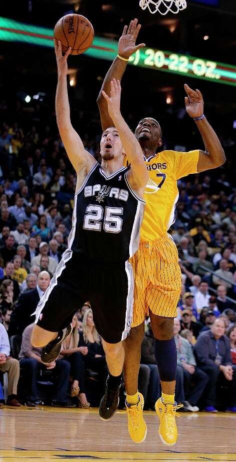 The Spurs' Nando De Colo (25) lays up a shot against the Warriors' Carl Landry during the first half Friday, Feb. 22, 2013, in Oakland, Calif. Photo: Ben Margot, Associated Press / AP