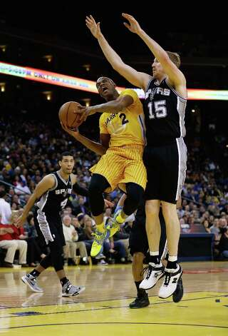 Jarrett Jack #2 of the Warriors goes up for a shot against Matt Bonner #15 of the Spurs at Oracle Arena on Feb. 22, 2013 in Oakland, California. Photo: Ezra Shaw, Getty Images / 2013 Getty Images