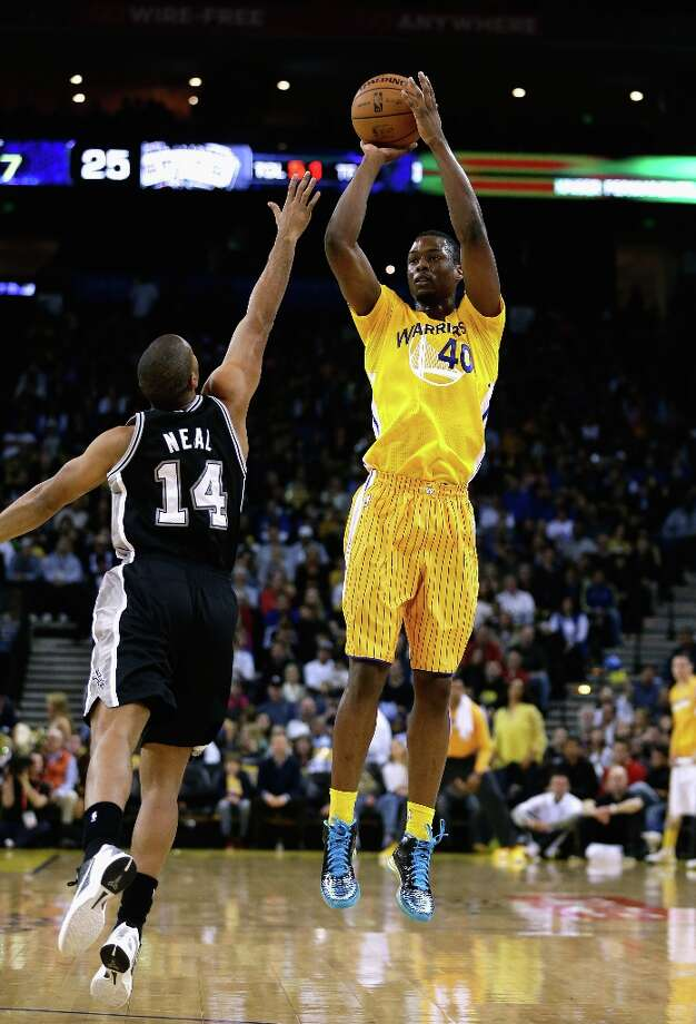 Harrison Barnes #40 of the Warriors shoots over Gary Neal #14 of the Spurs at Oracle Arena on Feb. 22, 2013 in Oakland, California. Photo: Ezra Shaw, Getty Images / 2013 Getty Images