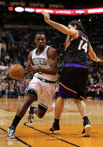 PHOENIX, AZ - FEBRUARY 22:  Jeff Green #8 of the Boston Celtics drives the ball against Luis Scola #14 of the Phoenix Suns during the first half of the NBA game at US Airways Center on February 22, 2013 in Phoenix, Arizona.  NOTE TO USER: User expressly acknowledges and agrees that, by downloading and or using this photograph, User is consenting to the terms and conditions of the Getty Images License Agreement.  (Photo by Christian Petersen/Getty Images) Photo: Christian Petersen