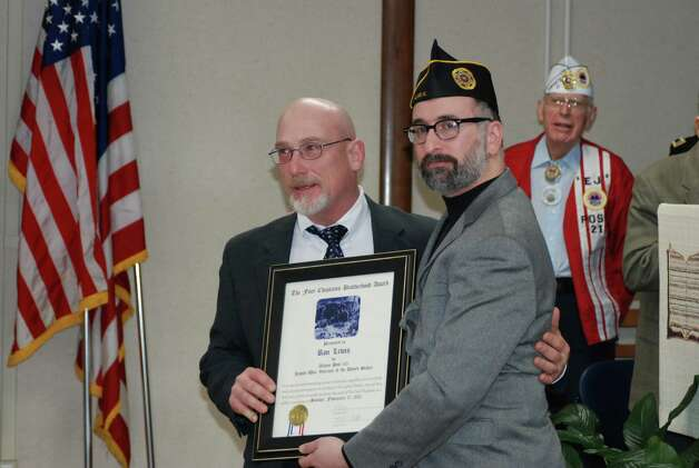 Richard Goldenberg / Jewish War Veterans Post 105 Ron Lewis, president of Patriot Flight, received the Four Chaplains Brotherhood Award from Lance Allan Wang, commander of Albany Post 105 of Jewish War Veterans, at Stratton Veterans Affairs Medical Center in Albany on Sunday. The award commemorates the sacrifice four military chaplains made in World War II.