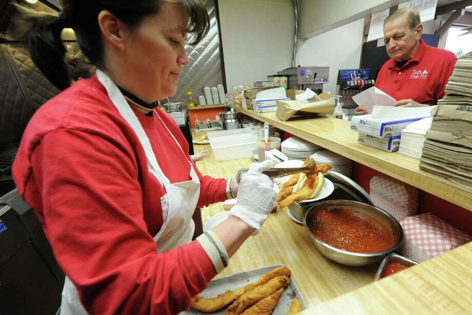 Manager Sue Fisher prepares a fish fry during lunch at Ted's Fish Fry on Friday Feb. 22, 2013 in Latham, N.Y. .(Michael P. Farrell/Times Union) Photo: Michael P. Farrell