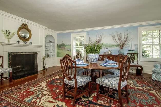 The formal dining room features three walls of hand-painted murals, one of which can be seen in the background. Photo: Rob Staub, Contributed Photo / Rob Staub