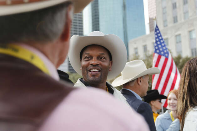 Texas A&M coach and former UH field boss Kevin Sumlin greets the parade goers on Saturday at the parade to kick off the Houston Livestock Show and Rodeo.