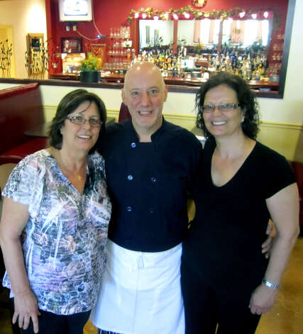 The Holiday Restaurant in New Milford has always been about family, both in its ownership and much of its patronage. The popular eatery headed into its second half-century in 2011 with Georgia Kapetanopoulos, left, and her sister, Helen Dafilis, guiding the restaurant with chef Michael Mosera.   June 2011 Photo: Norm Cummings