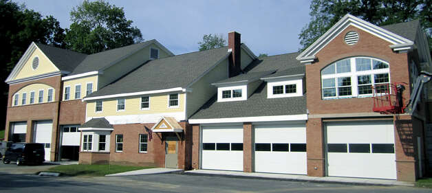 The dramatically expanded firehouse along Route 39 North in Sherman will be known in the community as the town's emergency services facility. 2011 Photo: Norm Cummings