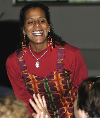 World-renowned New Milford native Valerie Tutson enthralls her audience at the United Methodist Church in New Milford with her initimitable storytelling talents. 2011 Photo: Norm Cummings