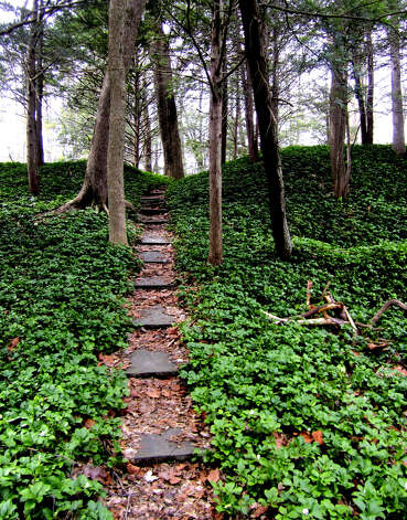 This secluded path is among the many wondrous settings awaiting patrons of scenic Harrybrooke Park, a privately owned but public-access jewel along Lanesville Road in New Milford. 2011 Photo: Norm Cummings