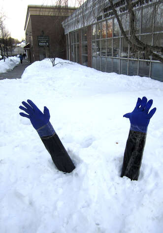 "A pair of ""arms"" stick out of the snow bank in front of New Milford Post Office after yet another winter snowstorm., Jan. 31, 2011. Photo: Norm Cummings"