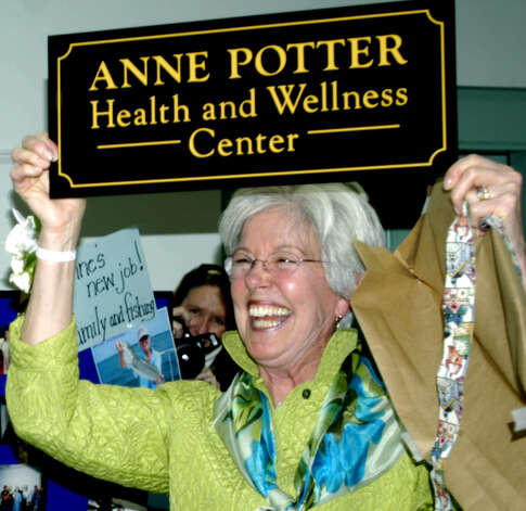 Longtime New Milford Senior Center director Anne Potter, a Washington resident, seems to love a new sign created for the occasion as she enjoys a surprise farewell party in her honor Feb. 25, 2011 at the New Milford Senior Center. Photo: Norm Cummings