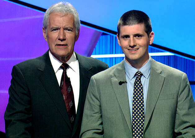 Brian McEntee, right, a former New Milford resident who graduated from New Milford High School, poses in 2011  for a photo with Jeopardy host Alex Trebek during the taping of a show.   Courtesy of Jeopardy Productions, Inc. Photo: Contributed Photo