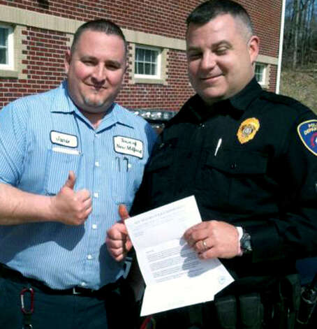 Town custodian Jamie Pritchard offers a sincere 'thumbs up' after Sgt. James Brady had saved him from choking March 28, 2011 at the New Milford Police Department. Photo: Max Steinmetz